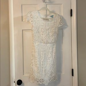 White mini lace dress with open back